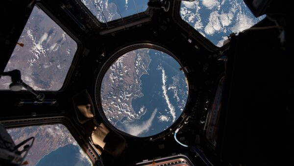 NASA astronaut Scott Kelly on the International Space Station took this Earth observation photo in the stations cupola that provides a 360 degree view. He tweeted this image with the comment: The view out my window. - Sputnik International