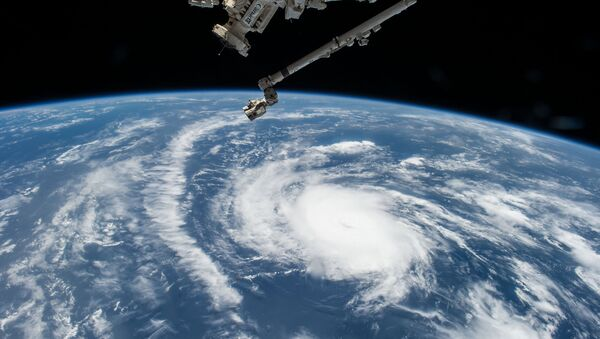 Hurricane Danny as seen from the International Space Station as it traversed the Caribbean Sea headed for Puerto Rico, the Dominican Republic and Cuba - Sputnik International