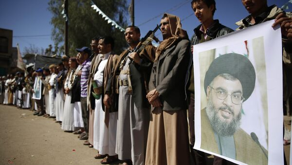 Shiite rebels, known as Houthis, hold a poster of Hezbollah leader Sheikh Hassan Nasrallah during a gathering to show their support to Hezbollah in Sanaa, Yemen, Thursday, March 3, 2016 - Sputnik International