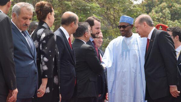 Turkey's President Recep Tayyip Erdogan, right, introduces Turkish businessmen to Nigerian President Muhammadu Buhari, during an official visit at the Presidential Palace in Abuja, Nigeria, Wednesday, March 2, 2016 - Sputnik International