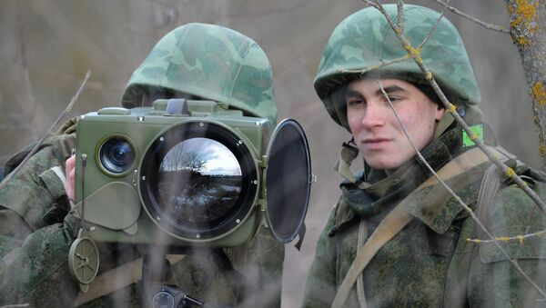 Soldiers of the technical intelligence unit handle an Ironia optical surveillance system during exercise of the Southern Military District special mission brigade in the Krasnodar Territory. The small-size multi-functional electronic optical device is designed for real-time obtaining and processing of information - Sputnik International
