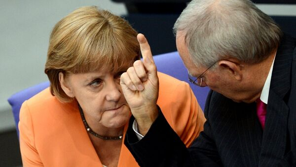 German Chancellor Angela Merkel (L) and German Finance Minister Wolfgang Schaeuble speaks during a session of the Bundestag, the lower house of parliament in Berlin on July 19, 2012. - Sputnik International