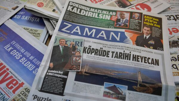 A photo taken in Ankara on March 6, 2016 shows the front page of the first new edition of the Turkish daily newspaper Zaman, which had staunchly opposed the president, now with articles supporting the government since its seizure by authorities - Sputnik International