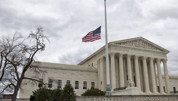 In this Feb. 25, 2016, file photo, in honor of Justice Antonin Scalia, a flag in the Supreme Court building's front plaza flies at half-staff in Washington - Sputnik International
