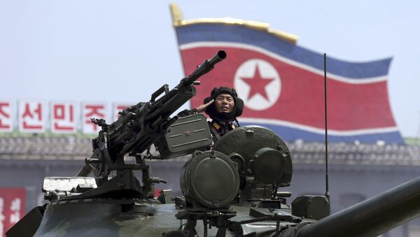 In this Saturday, July, 27, 2013, file photo, a North Korean soldier salutes while in a military tank as they parade through Kim Il Sung Sqaure during a mass military parade celebrating the 60th anniversary of the Korean War armistice in Pyongyang, North Korea - Sputnik International