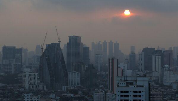 A partial solar eclipse is seen in Bangkok, Thailand, March 9, 2016. - Sputnik International