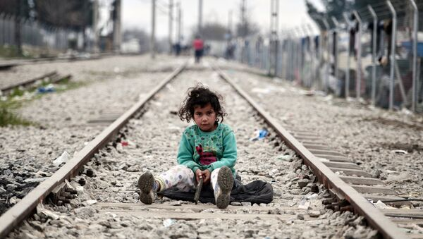A child plays on a rail track at the Greek-Macedonian border near the village of Idomeni where thousands of migrants and refugees are stranded on March 7, 2016. - Sputnik International