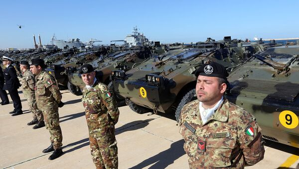 Italian Army soldiers stand by some of the twenty military vehicles during an handing over ceremony by Italy to Libya at a Libyan Navy Base on February 6, 2013 in Tripoli. - Sputnik International