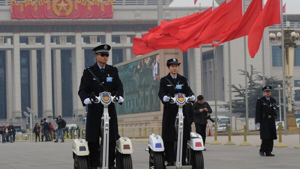 Police patrol outside the Great Hall of the People before the opening session at the 11th National Committee of the Chinese People's Political Consultative Conference (CPPCC) in Beijing on March 3, 2012. - Sputnik International