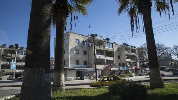 In this photo taken on Tuesday, March 1, 2016, a car passes on a street in Latakia, Syria. Associated Press spent five days traveling through the port of Latakia in Syria during the ceasefire. - Sputnik International
