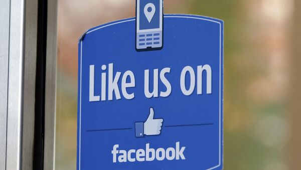 FILE - In this Dec. 13, 2011 file photo, a sign with Facebook's Like logo is posted at Facebook headquarters near the office for the company's User Operations Safety Team in Menlo Park, Calif. - Sputnik International