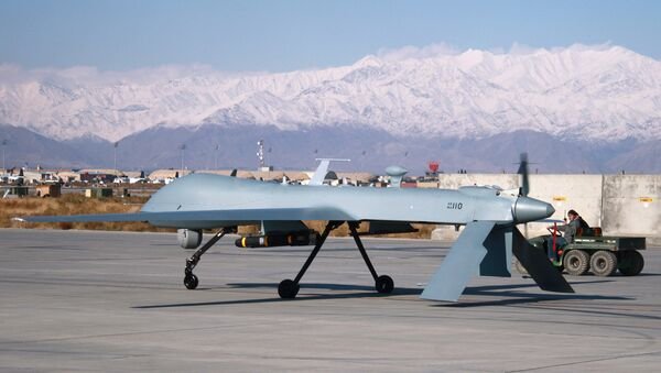 US Predator unmanned drone armed with a missile setting off from its hangar at Bagram air base in Afghanistan, November 27, 2009. - Sputnik International