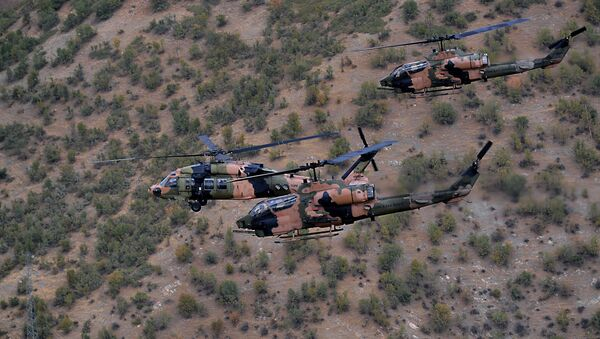 Military helicopters fly close to protect Turkish President Abdullah Gul and top army commanders aboard other helicopters over Hakkari province, Turkey as he visits Turkish troops at the border with Iraq.  - Sputnik International