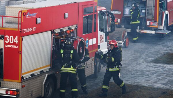 Officers at the Fire Control and Rescue Department of the Russian Emergency Ministry - Sputnik International