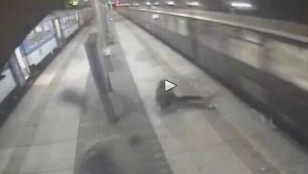 Two guys got airborned after train high speed nudge - Sputnik International