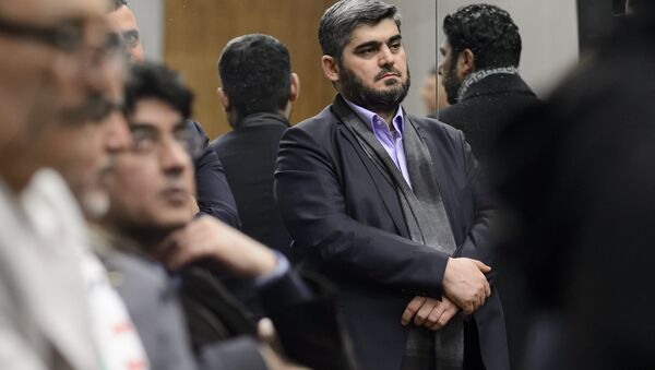 Chief negotiator for the main Syrian opposition body and rebel group Army of Islam, Mohammed Alloush (C) stands during a press conference after Syrian peace talks on February 3, 2016 in Geneva. (File) - Sputnik International