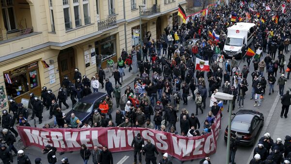 Far right-wing supporters march during rally against the German government's immigration policies and migrants, near-by the Chancellery in Berlin, Germany. - Sputnik International
