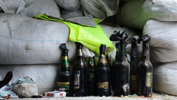 Bottles with Molotov cocktails at a checkpoint near Druzhba cafe burnt out in the armed clash outside Karlivka village, Donetsk Region. (File) - Sputnik International