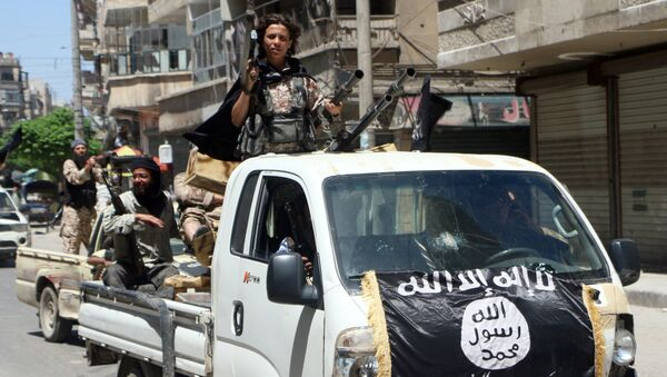 Fighters from Al-Qaeda's Syrian affiliate Al-Nusra Front drive in armed vehicles in the northern Syrian city of Aleppo as they head to a frontline, on May 26, 2015 - Sputnik International