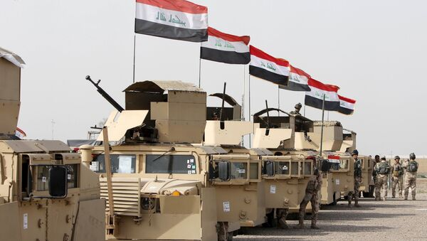 Iraqi security forces ride in vehicles travelling to Mosul to fight against militants of Islamic State at an Iraqi army base in Camp Taji in Baghdad, February 21, 2016 - Sputnik International