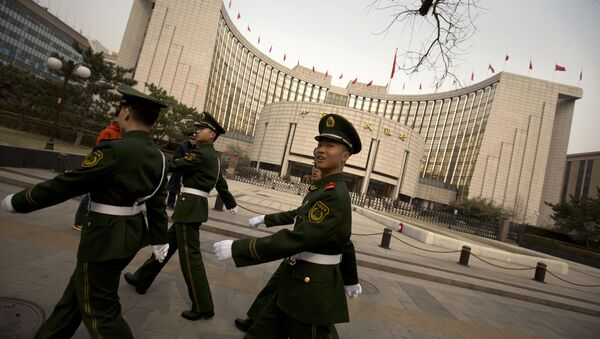 Chinese paramilitary police march past China's central bank, the People's Bank of China, in Beijing, Saturday, March 12, 2016 - Sputnik International