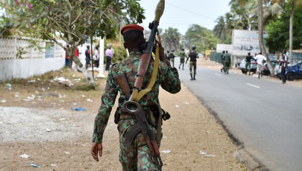 An armed soldier patrols in the streets of Grand Bassam, Ivory Coast, on March 14, 2016, a day after jihadist attackers stormed three hotels in the weekend resort. Ivory Coast ministers were to hold emergency talks on March 14 after the first jihadist attack in the country left 18 dead at a beach resort popular with foreigners, the latest such Islamist assault in West Africa - Sputnik International