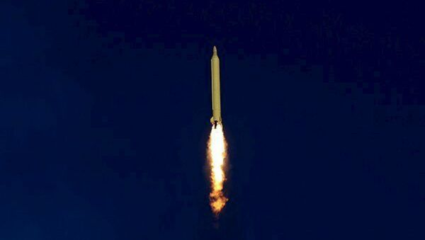 A ballistic missile is launched and tested in an undisclosed location, Iran, in this handout photo released by Farsnews on March 9, 2016 - Sputnik International