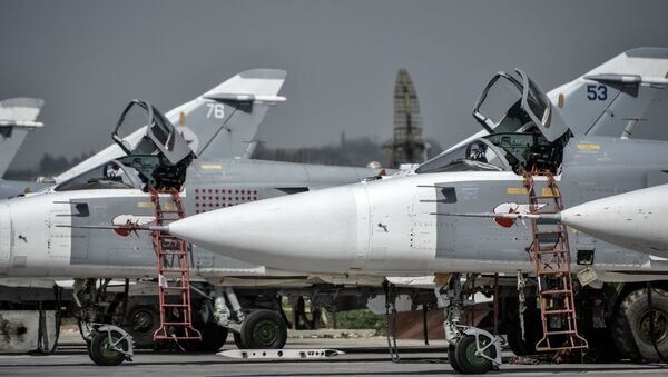 Russian Su-24 tactical bombers at the Hmeimim airbase in the Latakia Governorate of Syria - Sputnik International