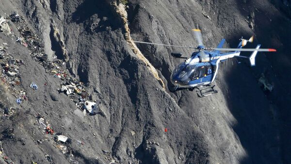 A French Gendarmerie rescue helicopter flies over the debris of the Germanwings Airbus A320 at the site of the crash, near Seyne-les-Alpes, France, in this picture taken on March 27, 2015. French BEA air accident investigators reported March 13, 2016 that a doctor had recommended that the German pilot who crashed a Germanwings jet into the Alps last year should be treated in a psychiatric hospital two weeks before the disaster - Sputnik International