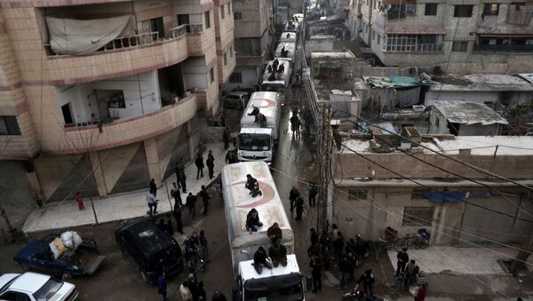 This file photo taken on February 23, 2016 shows a Red Crescent convoy carrying humanitarian aid arriveing in Kafr Batna, in the rebel-held Eastern Ghouta area, on the outskirts of the capital Damascus during an operation in cooperation with the UN to deliver aid to thousands of besieged Syrians - Sputnik International