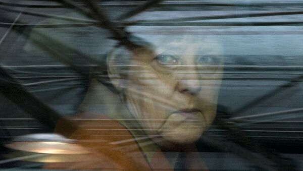 German Chancellor Angela Merkel looks out of her car window as she arrives for an EU summit at the EU Council building in Brussels on Monday, March 7, 2016 - Sputnik International