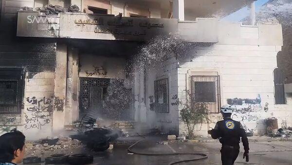 Burnt headquarters of al-Nusra Front in Maarat al-Numa - Sputnik International