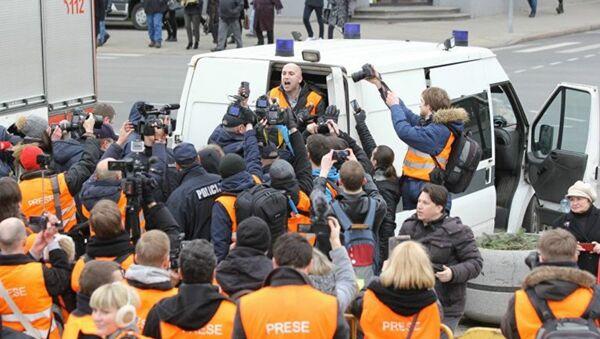 The arrest of journalist Graham Phillips at SS veterans' march in Riga, Latvia. March 16, 2016. - Sputnik International