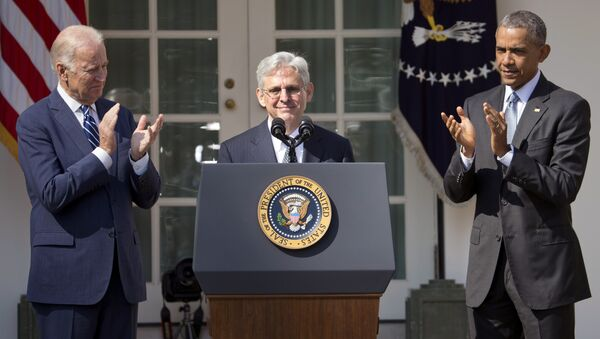 Federal appeals court judge Merrick Garland, receives applauds from President Barack Obama and Vice President Joe Biden as he is introduced as Obama's nominee for the Supreme Court during an announcement in the Rose Garden of the White House, in Washington, Wednesday, March 16, 2016 - Sputnik International