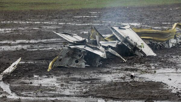Wreckage of the crashed Boeing 737-800 Flight FZ981 operated by Dubai-based budget carrier Flydubai, is seen at the airport of Rostov-On-Don, Russia - Sputnik International