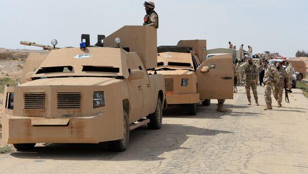 The Desert Falcons self-defense unit re-deploy outside Palmyra, Syria. - Sputnik International