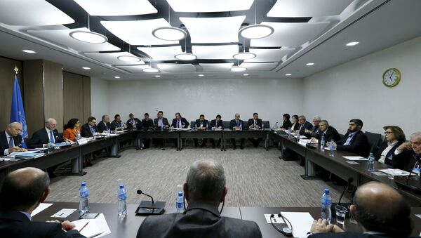 The delegation of the High Negotiations Committee (HNC) and U.N. mediator Staffan de Mistura are seen at the start of a meeting during Syria peace talks at the United Nations in Geneva, Switzerland, in this March 17, 2016 file photo - Sputnik International