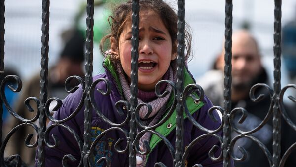 A migrant girl cries as she waits at a Turkish coast guard station at the Dikili district in Izmir, on March 20, 2016, after being catched with other migrants while trying to reach the Greek island of Lesbos from the Bademli village, western Turkey. - Sputnik International