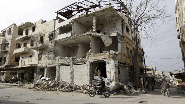 A man rides a motorbike near damaged buildings in the town of Marat Numan in Idlib province, Syria, March 19, 2016 - Sputnik International