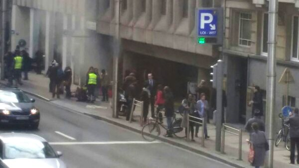 A picture taken on March 22, 2016 shows smoke rising from the Maalbeek underground, in Brussels, following a blast at the station close to the capital's European quarter. The Brussels metro service was being shut down on March 22, its operator said - Sputnik International