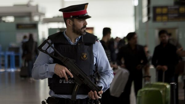 A police officer guards a terminal of the airport during tighter security measures in Barcelona, Spain, Tuesday, March 22, 2016 - Sputnik International