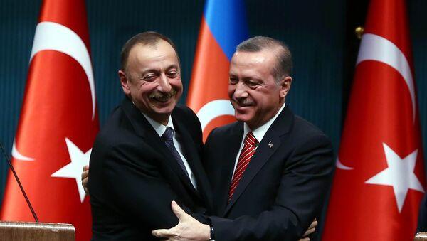 Azerbaijani President Ilham Aliyev (L) and Turkish President Recep Tayyip Erdogan (R) huging after signing bilateral agreements following the 5th Turkey-Azerbaijan High Level Strategic Cooperation Council meeting at the Presidential Complex in Ankara - Sputnik International