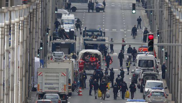 Belgian police and emergency personnel work near the Maalbeek metro station following an explosion in Brussels, Belgium, March 22, 2016 - Sputnik International