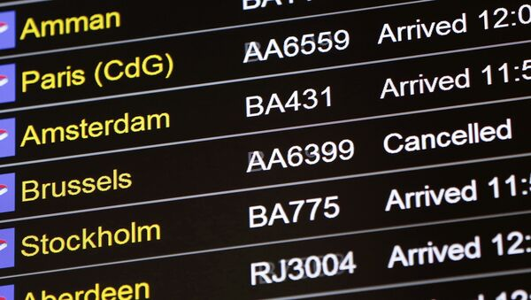An arrivals board displays a cancelled flight from Brussels with an American Airlines code at Terminal 5, Heathrow Airport in London, Britain March 22, 2016 - Sputnik International
