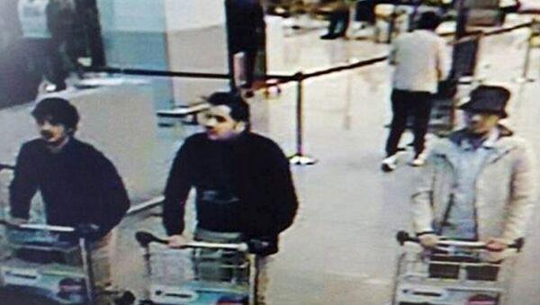 CCTV surveillance image shows three men identified as suspects in the Brussels attacks. - Sputnik International