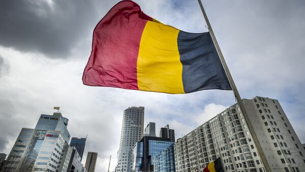 The Belgian flag flying at half-mast is pictured at the Hofplein in Rotterdam, on March 23, 2016. - Sputnik International