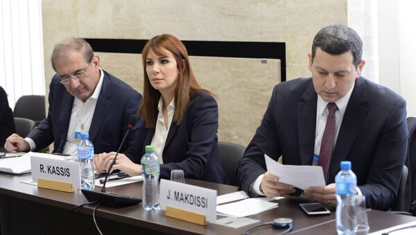 Syria's former deputy Prime Minister Qadri Jamil (L), Randa Kassis (C) and Jihad Makdissi, members of Syria's opposition react before a round of negotiations between Syria's opposition and the U.N., at the European headquarters of the United Nations in Geneva, Switzerland, March 23, 2016 - Sputnik International