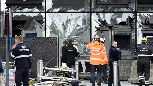 Broken windows of the terminal at Brussels national airport are seen during a ceremony following bomb attacks in Brussels metro and Belgium's National airport of Zaventem, Belgium, March 23, 2016 - Sputnik International