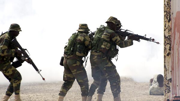 Senegalese soldiers take part on a large annual military exercise, known as Flintlock, on February 24, 2016, in Thies. The exercise has been bringing together African, European and US counter-terrorism forces every year for the past decade - Sputnik International