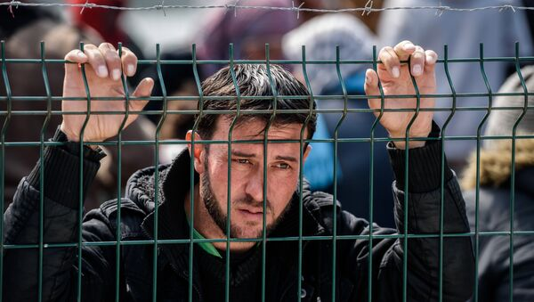 A migrant waits at a Turkish coast guard station at the Dikili district in Izmir, on March 20, 2016 after being catched with other migrants while trying to reach the Greek island of Lesbos from the Bademli village, western Turkey. - Sputnik International